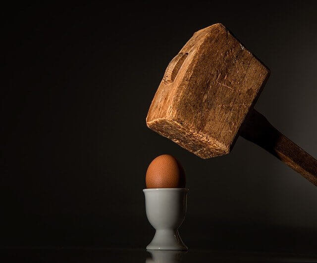 egg being hit with a hammer